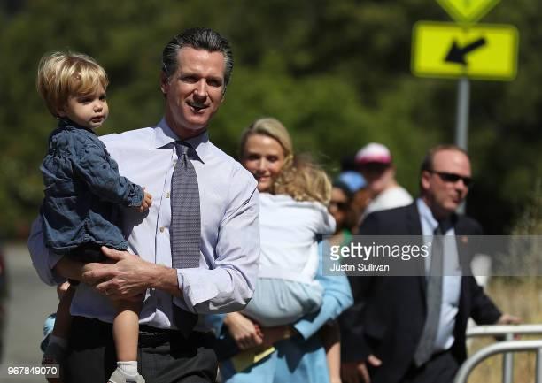 Democratic California gubernatorial candidate Lt. Gov. Gavin Newsom walks with his son Dutch, before voting at the Masonic Temple Fairfax on June 5,...