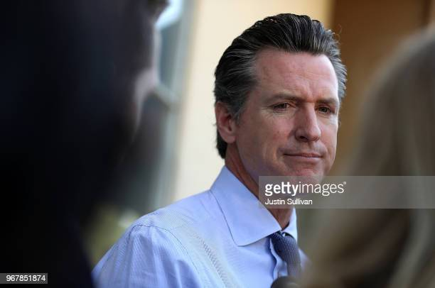 Democratic California gubernatorial candidate Lt Gov Gavin Newsom talks with reporters after voting at the Masonic Temple Fairfax on June 5 2018 in...