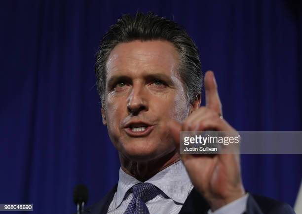 Democratic California gubernatorial candidate Lt Gov Gavin Newsom speaks during his primary election night gathering on June 5 2018 in San Francisco...