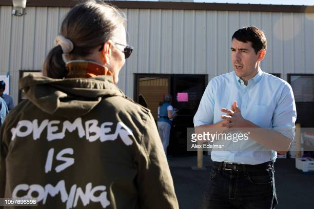 Democratic candidate for California's 10th Congressional District Josh Harder talks with a supporter during a 'Get Out the Vote' campaign event on...