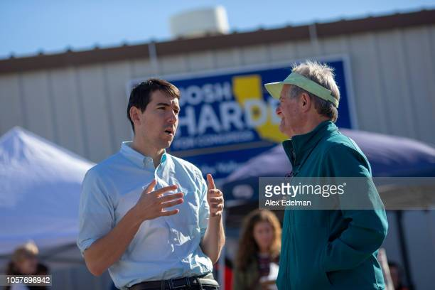 Democratic candidate for California's 10th Congressional District Josh Harder talks with Harvey Brody of San Francisco during a 'Get Out the Vote'...