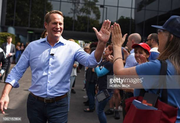 Democratic candidate for Congress Harley Rouda greets supporters in Huntington Beach, California, on October 14, 2018. - Rouda is running as a...