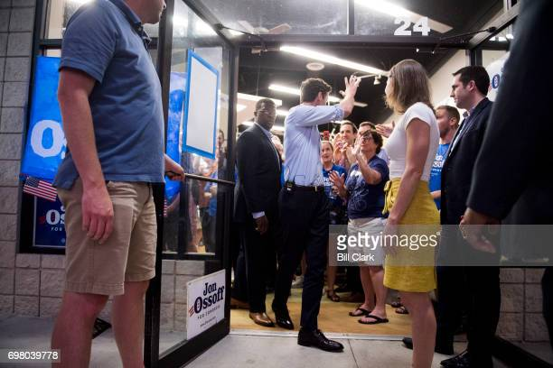 Democratic candidate for Georgia's 6th Congressional district Jon Ossoff waves to supporters as he and his his fiancee Alisha Kramer leave his final...