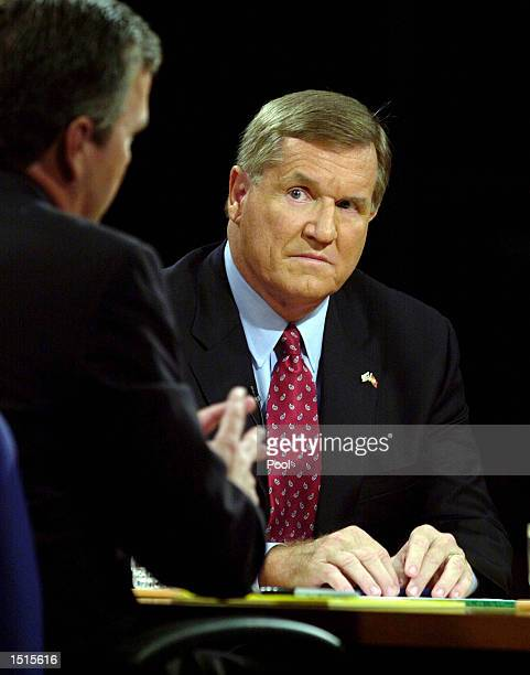 Democratic candidate for governor Bill McBride listens to his opponent incumbent Governor Jeb Bush during a debate at the University of Central...