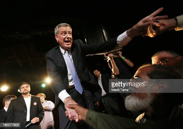 Democratic candidate for Mayor Bill de Blasio greets well wishers at his primary night party on September 11 2013 in the Brooklyn borough of New York...