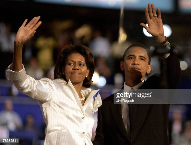 Democratic candidate for the United States Senate in Illinois Barack Obama and his wife Michelle Obama wave to the crowd at the Democratic National...