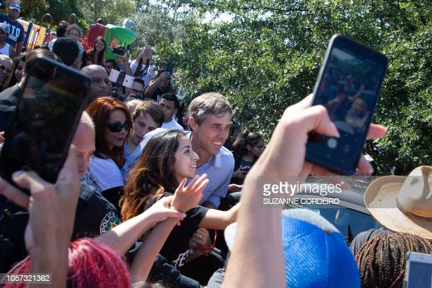 Democratic candidate for the US Senate Beto ORourke poses with supporters following his last public event in Austin before election night at the Pan...
