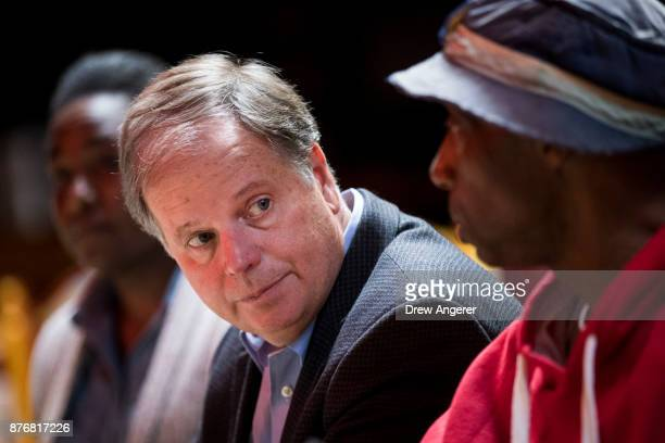 Democratic candidate for US Senate Doug Jones meets with supporters and voters at a Mexican restaurant November 20 2017 in Talladega Alabama Jones...