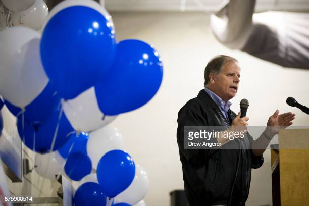 Democratic candidate for US Senate Doug Jones speaks at a fish fry campaign event at Ensley Park November 18 2017 in Birmingham Alabama Jones has...