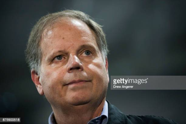 Democratic candidate for US Senate Doug Jones takes questions from reporters at a fish fry campaign event at Ensley Park November 18 2017 in...