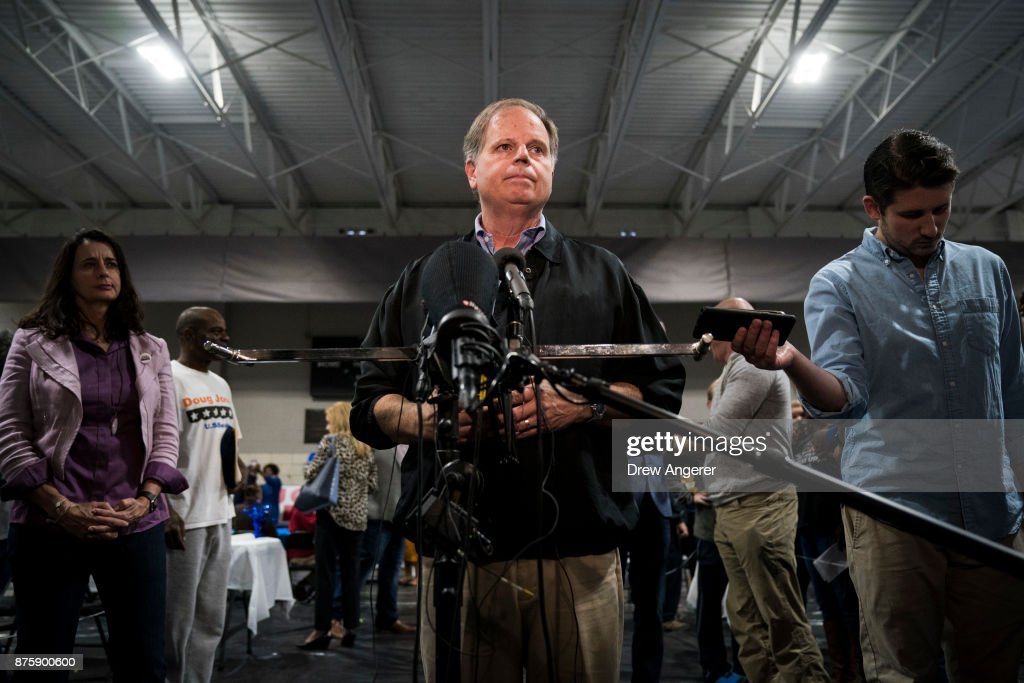 Democratic candidate for U.S. Senate Doug Jones takes questions from reporters at a fish fry campaign event at Ensley Park, November 18, 2017 in Birmingham, Alabama. Jones has moved ahead in the polls of his Republican opponent Roy Moore, whose campaign has been rocked by multiple allegations of sexual misconduct.