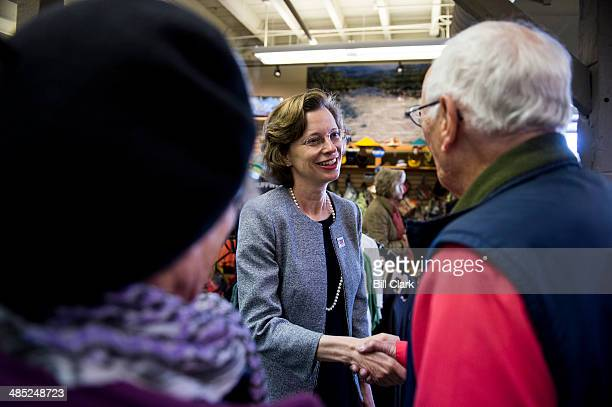 Democratic candidate for US Senate Michelle Nunn shakes hands as she tours the Whitewater Express rafting business by the Chattahoochee River in...