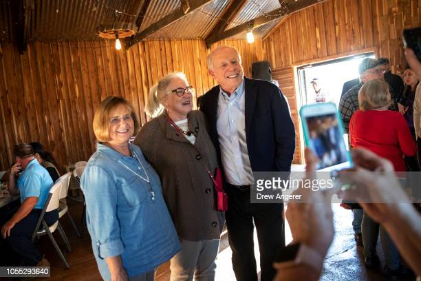 Democratic candidate for US Senate Phil Bredesen poses for photos with supporters before the start of a GetOutTheVote rally October 29 2018 in...