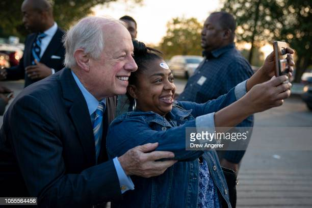 Democratic candidate for US Senate Phil Bredesen takes a photo with a voter during an early vote rally and fish fry outside the Bordeaux Branch of...