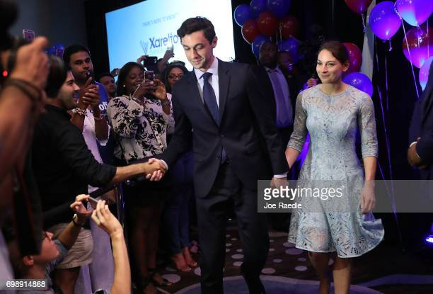 Democratic candidate Jon Ossoff and and his fiancee Alisha Kramer arrive as he prepares to give a concession speech speak during his election night...