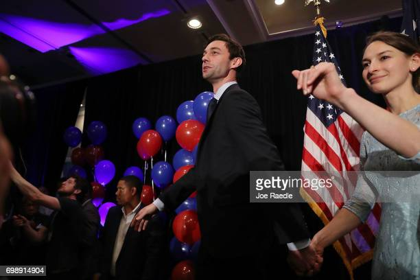 Democratic candidate Jon Ossoff and and his fiancee Alisha Kramer exit after he gave a concession speech speak during his election night party being...