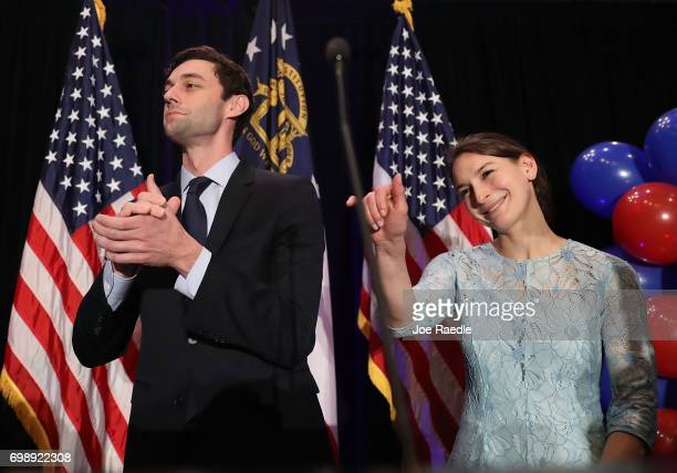 Democratic candidate Jon Ossoff and and his fiancee Alisha Kramer prepare to exit after he gave a concession speech speak during his election night...