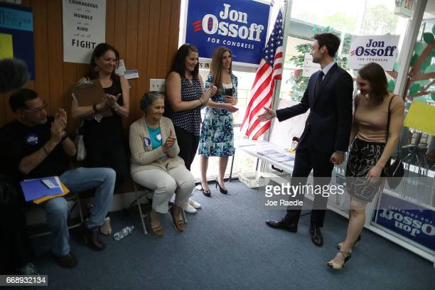Democratic candidate Jon Ossoff and his girlfriend Alisha Kramer greet supporters at a campaign office as he runs for Georgia's 6th Congressional...