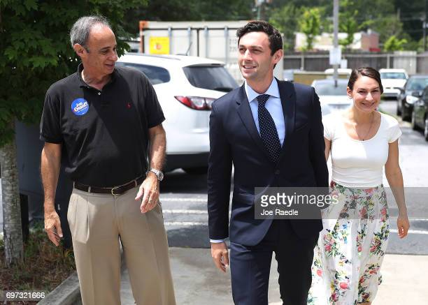 Democratic candidate Jon Ossoff and his girlfriend Alisha Kramer walk with his father Richard Ossoff who appeared with them on Father's Day to thank...
