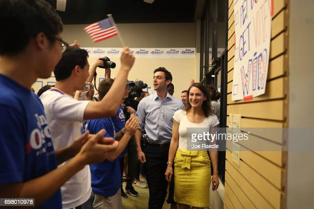 Democratic candidate Jon Ossoff arrives with his fiancee Alisha Kramer to thank volunteers and supporters on the last night before election day as he...