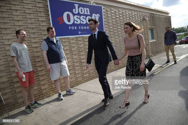 Democratic candidate Jon Ossoff arrives with his girlfriend Alisha Kramer to greet supporters at a campaign office as he runs for Georgia's 6th...
