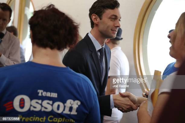 Democratic candidate Jon Ossoff greets people as he thanks volunteers and supporters during a stop at a campaign office as he runs for Georgia's 6th...