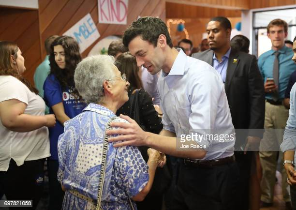 Democratic candidate Jon Ossoff greets people during a visit to a campaign office to thank volunteers and supporters as he runs for Georgia's 6th...