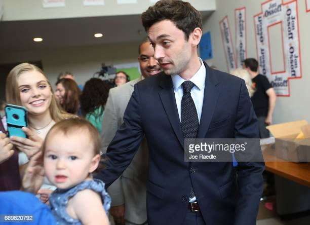Democratic candidate Jon Ossoff greets volunteers and supporters at a campaign office as he runs for Georgia's 6th Congressional District on April 18...