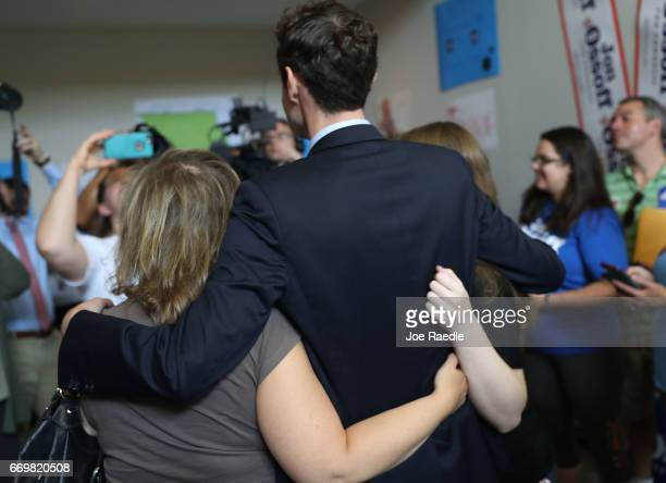 Democratic candidate Jon Ossoff poses for a picture with supporters at a campaign office as he runs for Georgia's 6th Congressional District on April...
