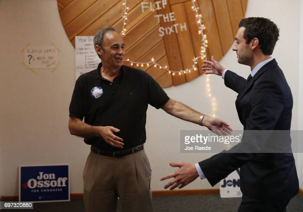Democratic candidate Jon Ossoff prepares to hug his father Richard Ossoff who appeared with him on Father's Day to thank volunteers and supporters as...