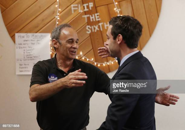 Democratic candidate Jon Ossoff prepares to hug his father Richard Ossoff who appeared with him on Father's Day to thank volunteers and supporters at...