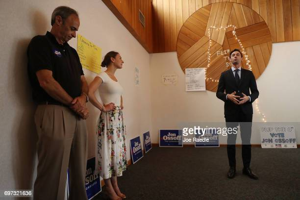 Democratic candidate Jon Ossoff says thanks to supporters and volunteers as his girlfriend Alisha Kramer and father Richard Ossoff listen at a...