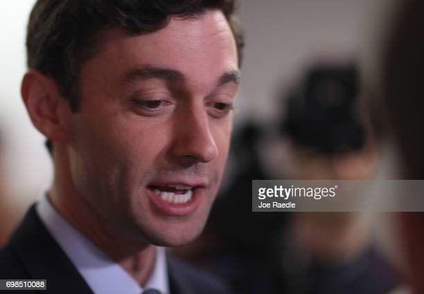 Democratic candidate Jon Ossoff speaks during a visit to a campaign office to speak with volunteers and supporters on election day as he runs for...