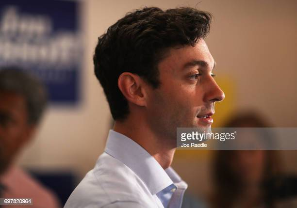 Democratic candidate Jon Ossoff speaks to the media during a visit to a campaign office to thank volunteers and supporters as he runs for Georgia's...