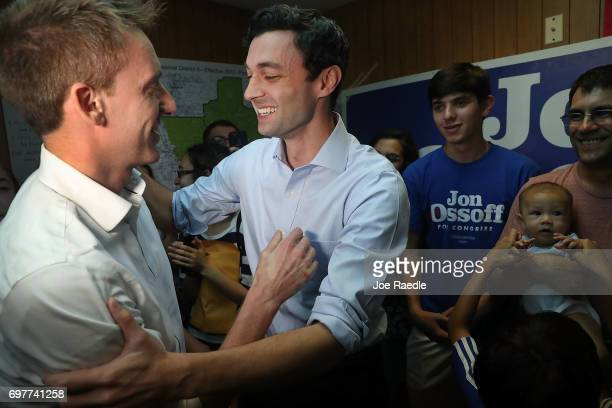 Democratic candidate Jon Ossoff speaks with Jason Kander as he visits a campaign office to thank volunteers and supporters as he runs for Georgia's...