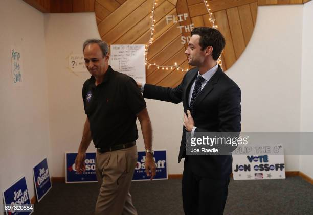 Democratic candidate Jon Ossoff stands with his father Richard Ossoff who appeared with him on Father's Day to thank volunteers and supporters as he...
