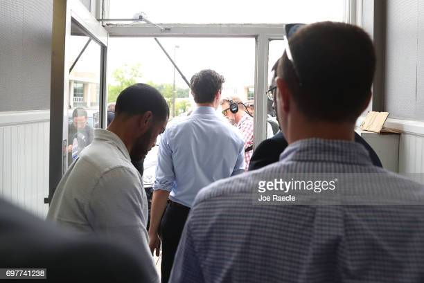 Democratic candidate Jon Ossoff walks out to speak to the media after a visit to a campaign office to thank volunteers and supporters as he runs for...