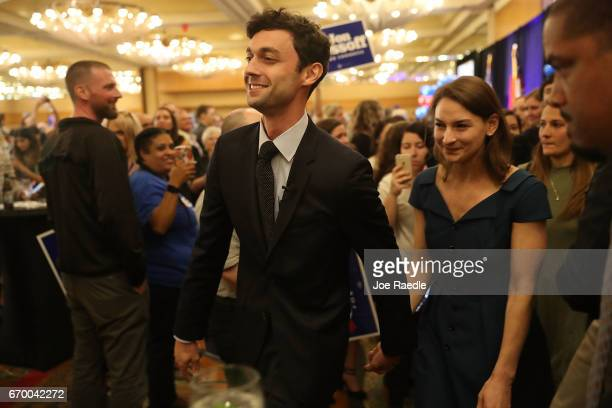 Democratic candidate Jon Ossoff walks with his girlfriend Alisha Kramer after speaking to his supporters as votes continue to be counted in a race...