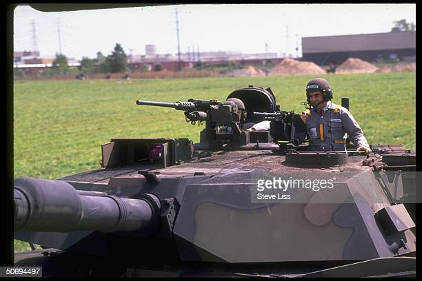 Democratic candidate Michael Dukakis riding on M1A tank in presidential campaign stop at General Dynamics plant
