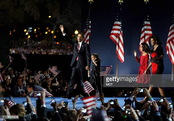 Democratic candidate Sen Barack Obama comes out to greet the crowd along with his wife Michelle and children Malia and Sasha 7 at his Election Night...