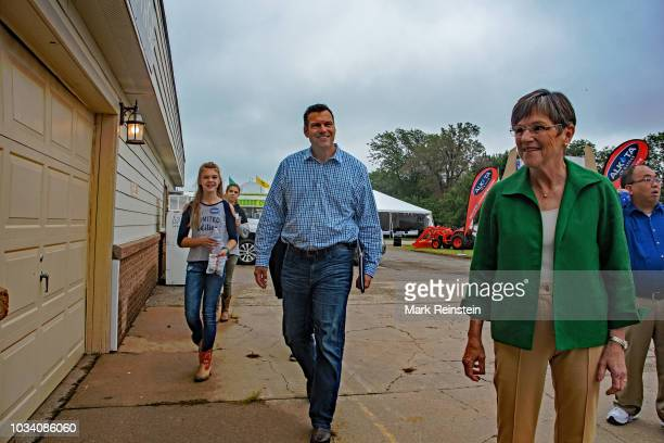 Democratic candidate state senator Laura Kelly pauses backstage as her Republican opponent Kansas Secretary of State Kris Kobach walks up behind her...