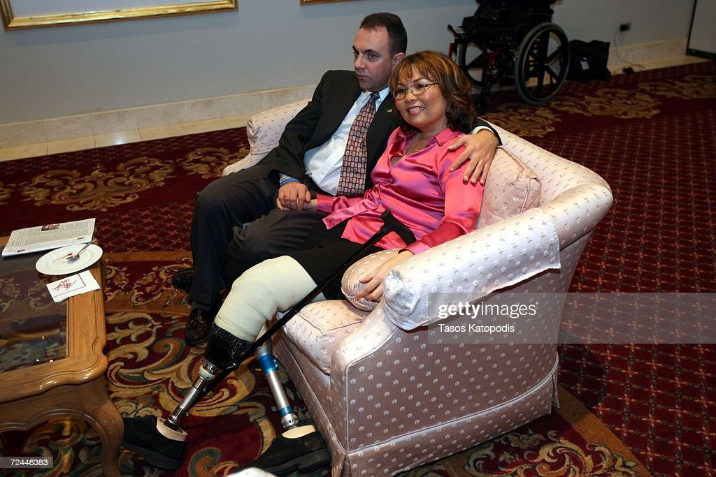 Democratic candidate Tammy Duckworth and her husband Bryan Bowlsbey watch election returns on November 7, 2006 in Oakbrook, Illinois. Duckworth, a former Army helicopter pilot who lost both legs due to injuries in Iraq, is running against Republican Peter Roskam for the Sixth District Congressional seat.