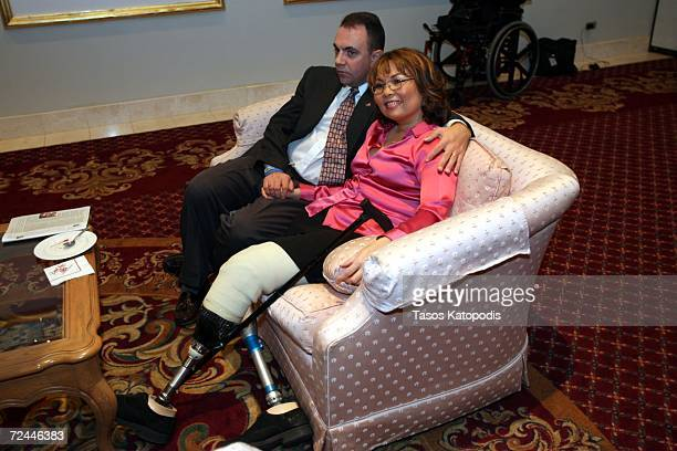 Democratic candidate Tammy Duckworth and her husband Bryan Bowlsbey watch election returns on November 7 2006 in Oakbrook Illinois Duckworth a former...
