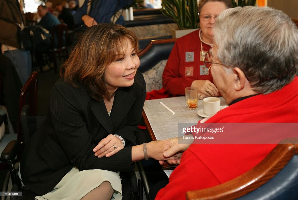 Democratic candidate Tammy Duckworth greets people at Maxfields Pancake House on Election Day November 7, 2006 in Lombard, Illinois. Duckworth, a former army helicopter pilot who lost both legs due to injuries in Iraq, is running against Republican Peter Roskam for the Sixth District Congressional seat.