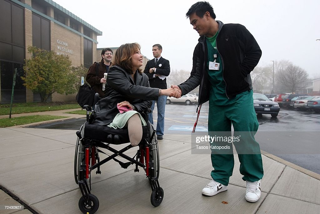 Democratic candidate Tammy Duckworth greets people in the parking lot of Glenn Westlake Middle School on Election Day November 7, 2006 in Lombard, Illinois. Duckworth, a former Army helicopter pilot who lost both legs due to injuries in Iraq, is running against Republican Peter Roskam for the Sixth District Congressional seat.
