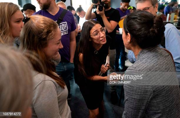 Democratic congressional candidate Alexandria OcasioCortez greets supporters as she arrives for her general campaign kickoff rally on September 22...