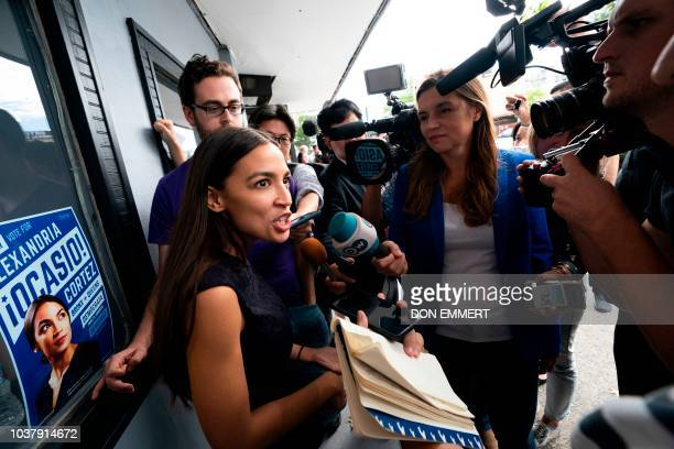 Democratic congressional candidate Alexandria OcasioCortez speaks with reporters after her general campaign kickoff rally on September 22 2018 in the...