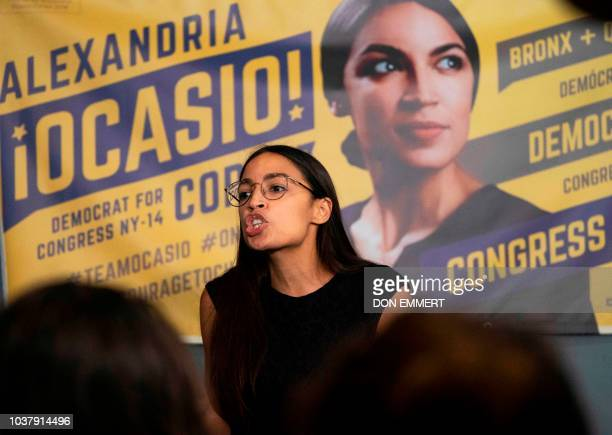 Democratic congressional candidate Alexandria OcasioCortez talks with supporters during her general campaign kickoff rally on September 22 2018 in...