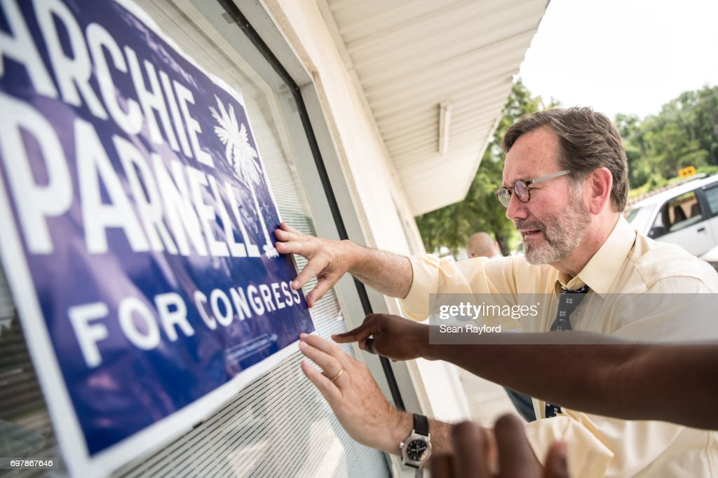 Democratic congressional candidate Archie Parnell hangs up a campaign sign June 19, 2017 in Bishopville, South Carolina. Voters will choose between Parnell and Republican candidate Ralph Norman tomorrow in a special election for South Carolina's 5th Congressional District House seat.