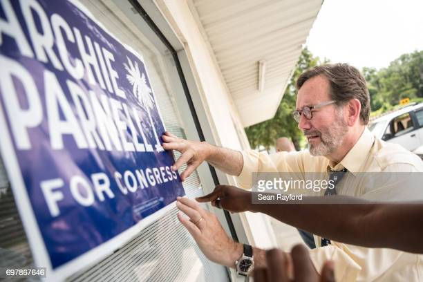 Democratic congressional candidate Archie Parnell hangs up a campaign sign June 19 2017 in Bishopville South Carolina Voters will choose between...